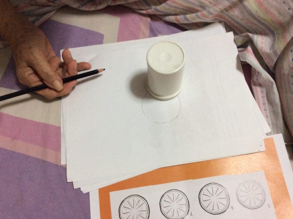 My grandma tracing an object to draw a circle